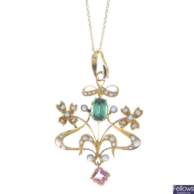 An Edwardian 15ct gold split pearl and tourmaline pendant, with later 9ct gold chain.