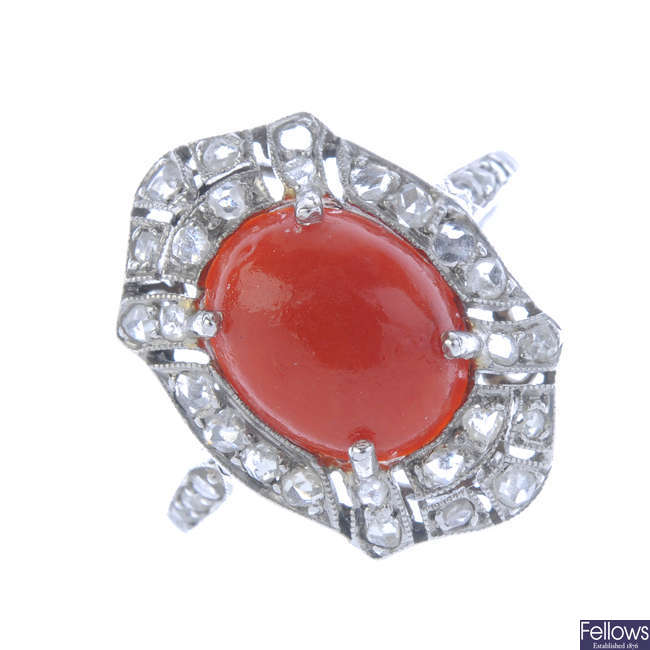A coral and diamond cluster ring.