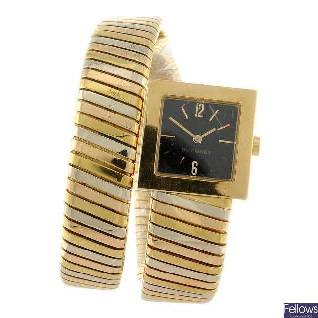 BULGARI - a lady's yellow metal Tubogas bracelet watch.