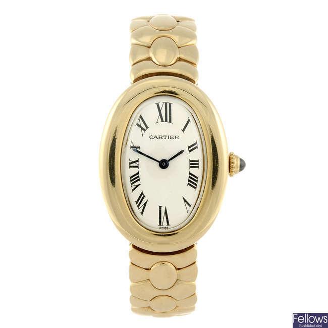 CARTIER - a yellow metal Baignoire bracelet watch.