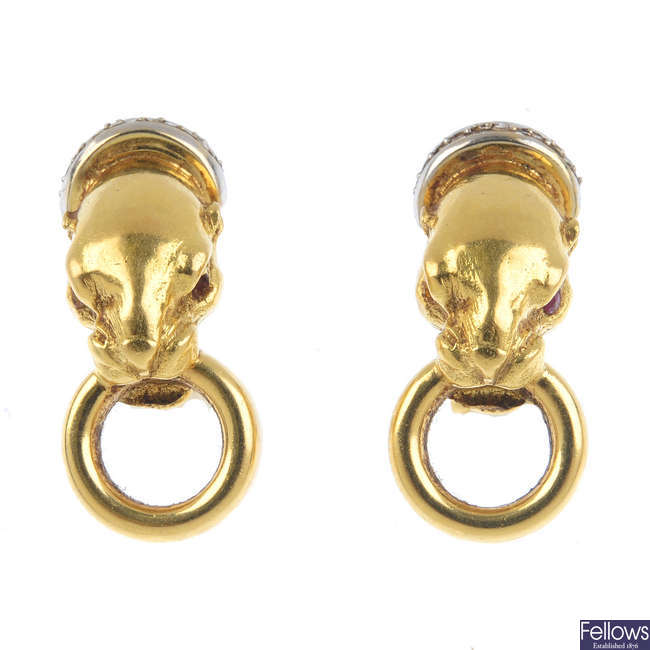 A pair of panther earrings.