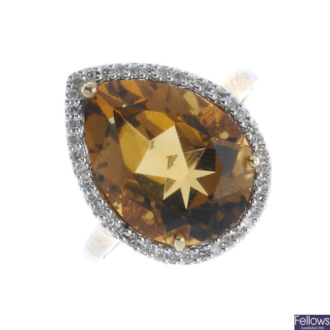 A 9ct gold citrine and diamond cluster ring.