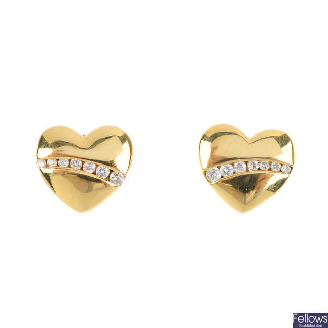 A pair of 18ct gold diamond heart earrings.