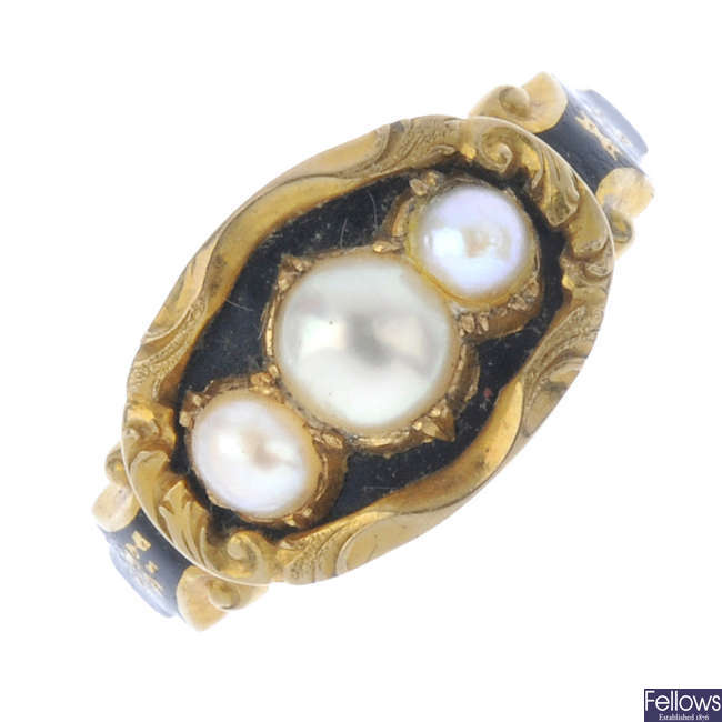 A mid Victorian split pearl and enamel memorial ring.