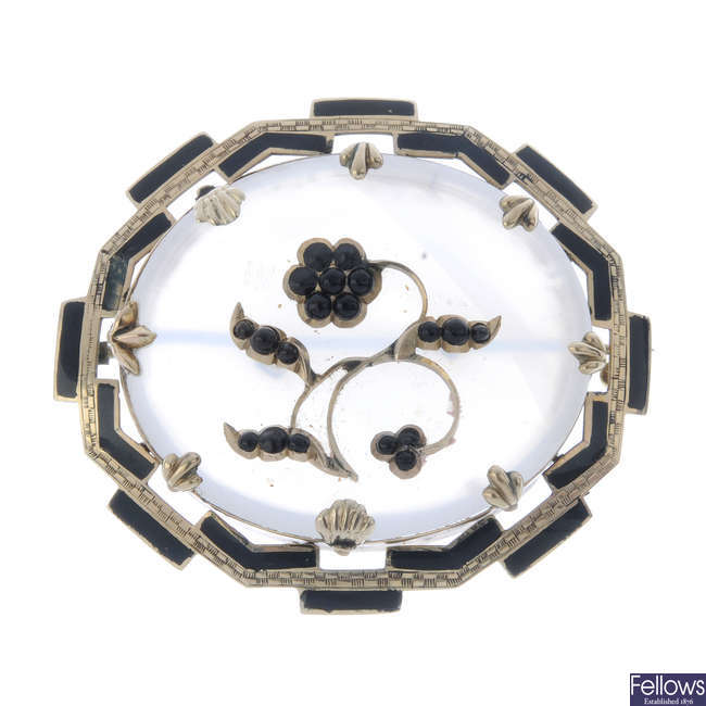 A late Victorian chalcedony and enamel brooch.