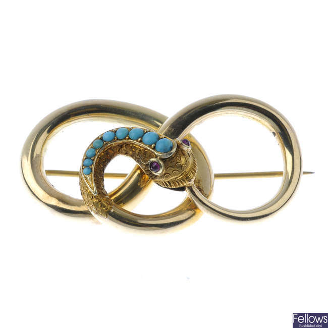 A mid Victorian gold, turquoise and garnet snake brooch.