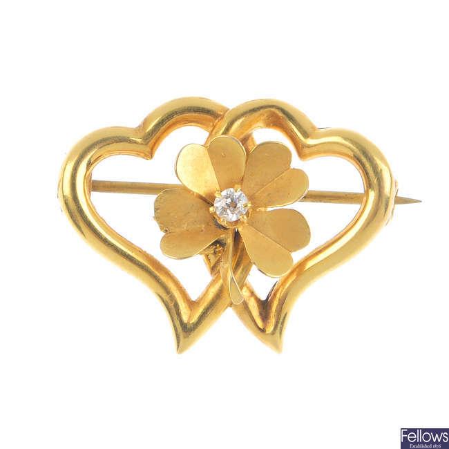 An Edwardian 15ct gold diamond brooch.