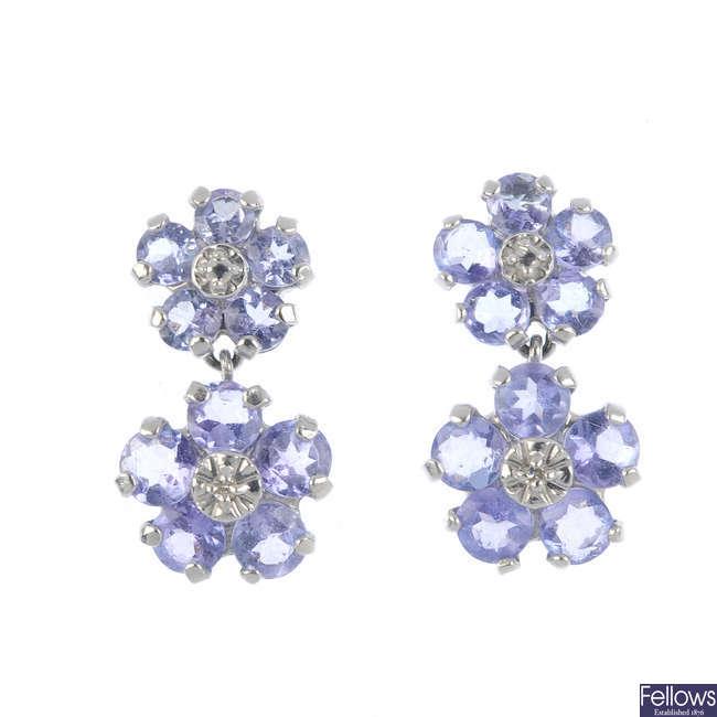 A pair of diamond and tanzanite earrings.