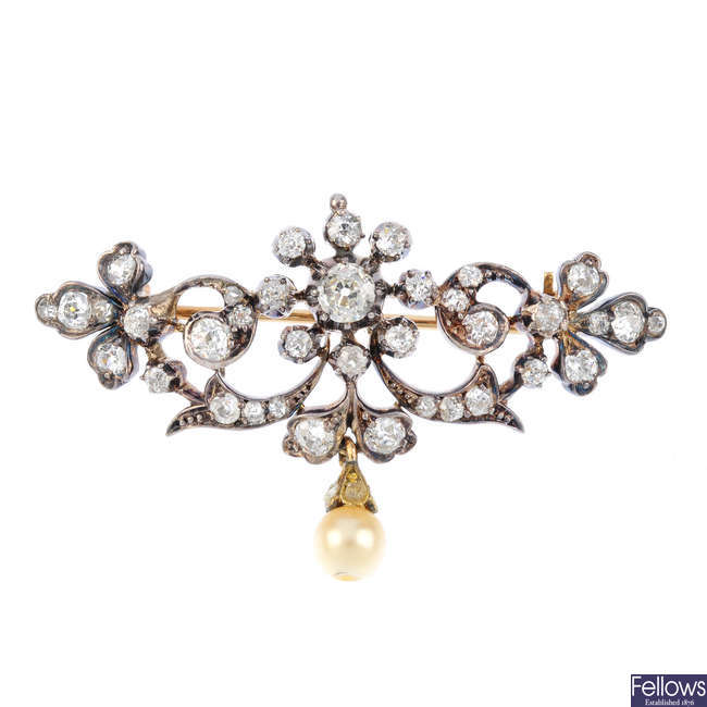 An early 20th century diamond and cultured pearl brooch.