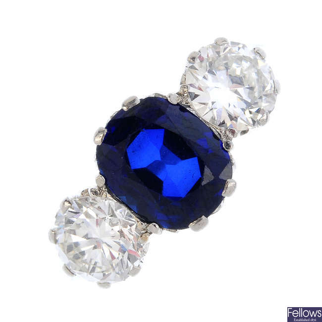 An early 20th century platinum synthetic sapphire and diamond three-stone ring.