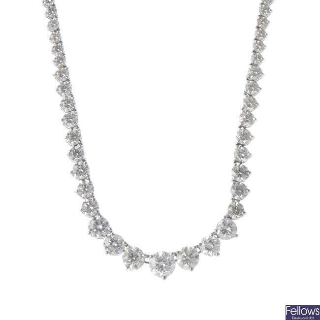 A diamond line necklace.