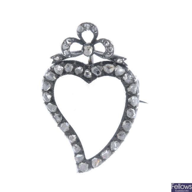 A moonstone and diamond brooch.