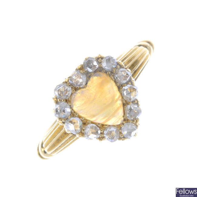 An Edwardian 18ct gold opal and diamond cluster ring.