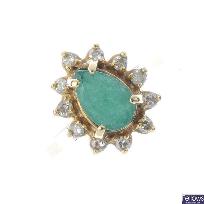 An emerald and diamond cluster ring.