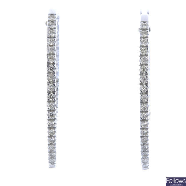 A pair of 18ct diamond earrings.