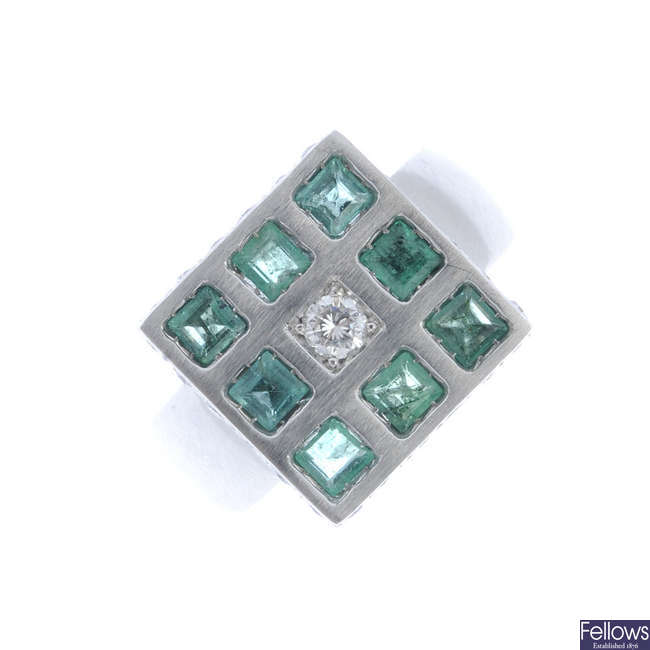 An emerald and diamond dress ring square-shape panel.