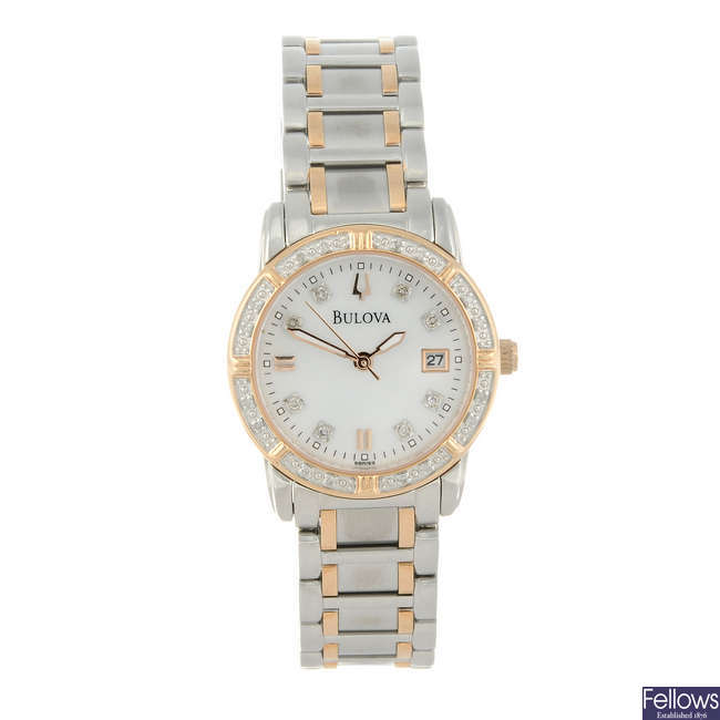 BULOVA - a lady's bi-colour bracelet watch with two other watches.