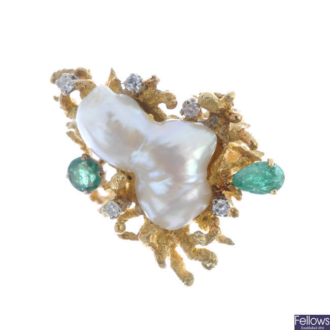A 1970s baroque cultured pearl, emerald and diamond dress ring.