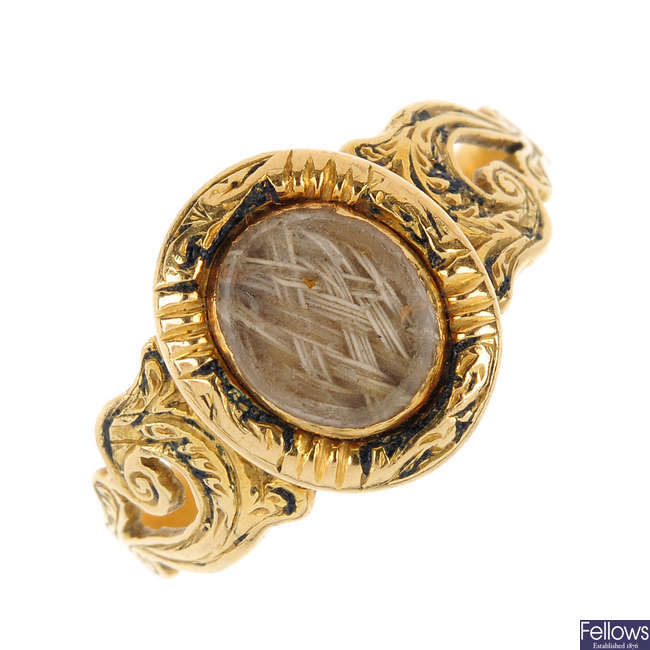 A mid Victorian 18ct gold memorial ring.