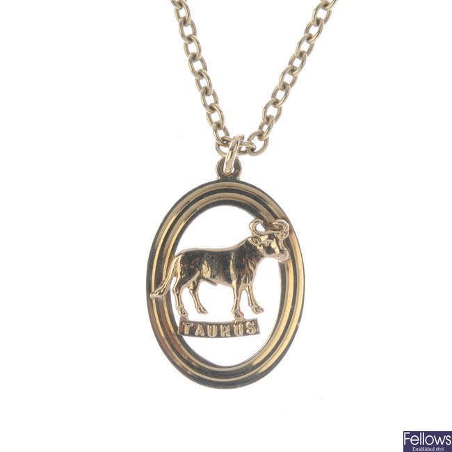 A 1970s 9ct gold astrological pendant, with chain.