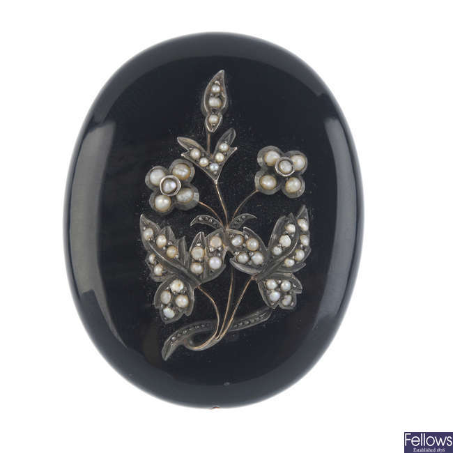 A late Victorian onyx and split pearl memorial brooch.