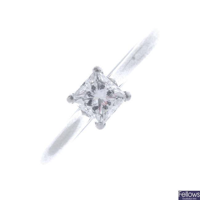 A platinum diamond singe-stone ring.