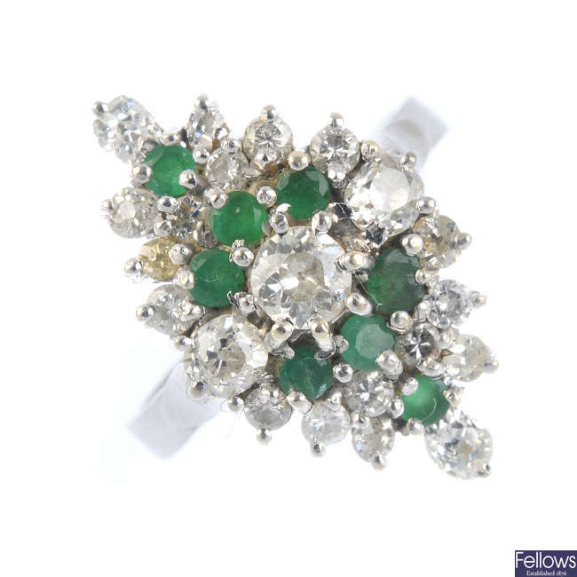 An 18ct gold diamond and emerald cluster ring.