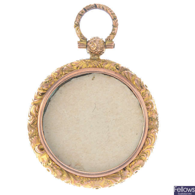 A late 19th century 9ct gold photograph pendant.