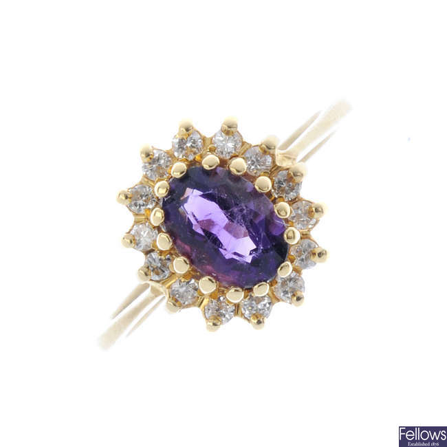 An 18ct gold diamond and amethyst cluster ring.
