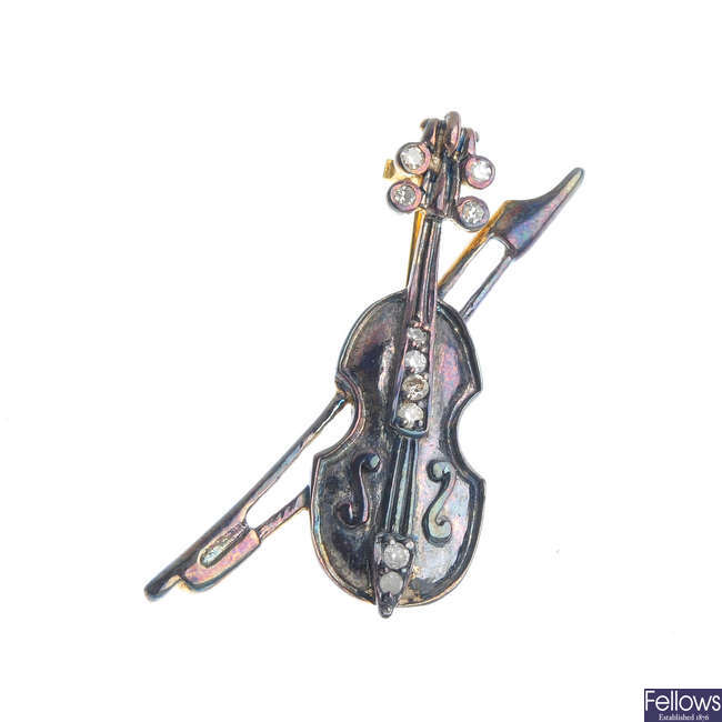 A diamond violin brooch.