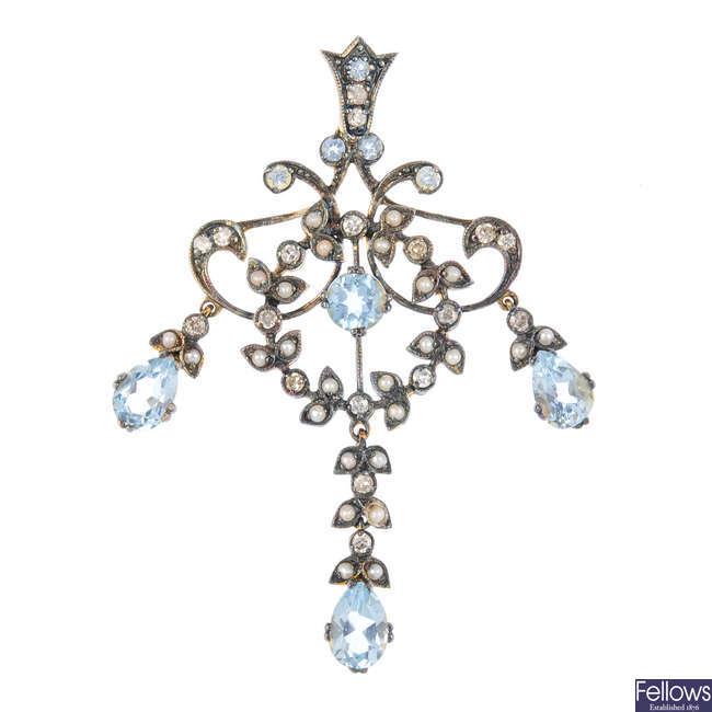 A topaz, split pearl and diamond pendant.
