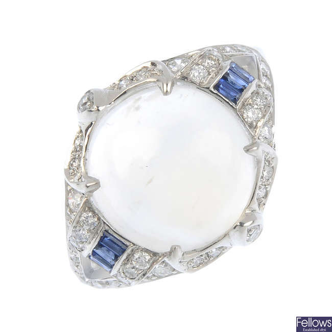 A moonstone, diamond and sapphire ring.