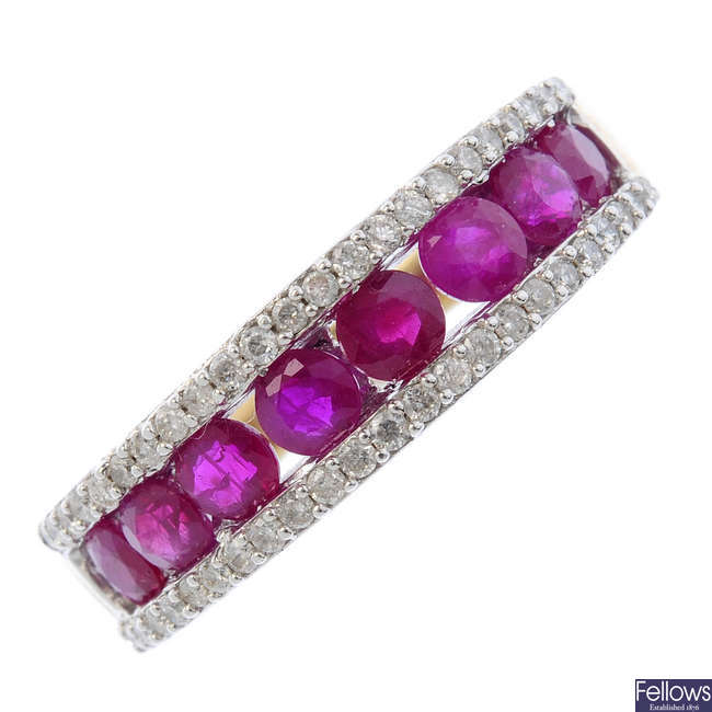 A 9ct gold ruby and diamond half-circle eternity ring.