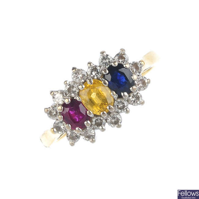 An 18ct gold diamond and gem-set cluster ring.