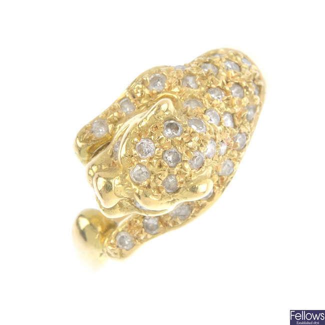 A diamond panther ring.