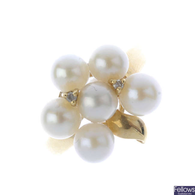 A cultured pearl and diamond dress ring and a pair of earrings.