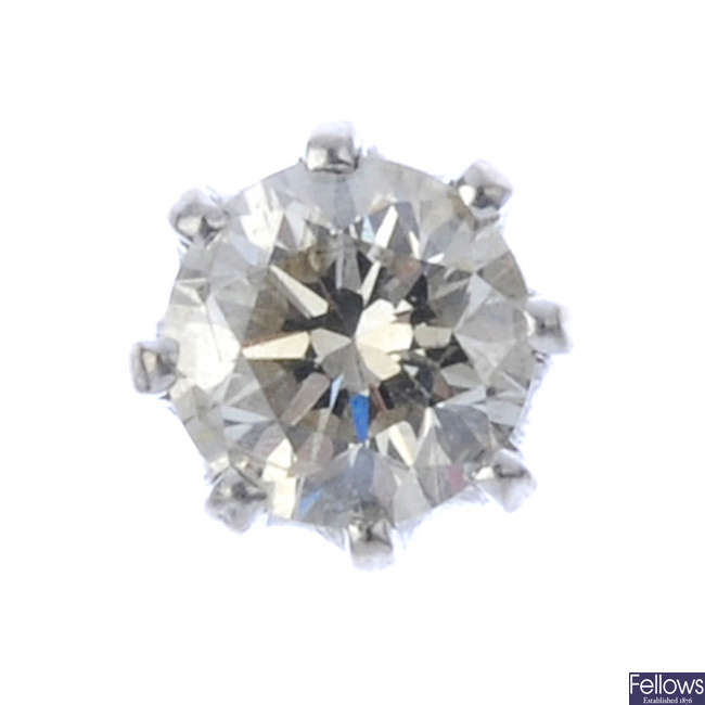 A brilliant-cut diamond single ear stud.