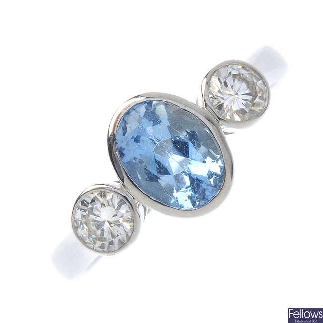 An 18ct gold aquamarine and diamond three-stone ring.
