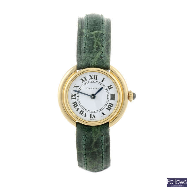 CARTIER - a yellow metal Ellipse wrist watch