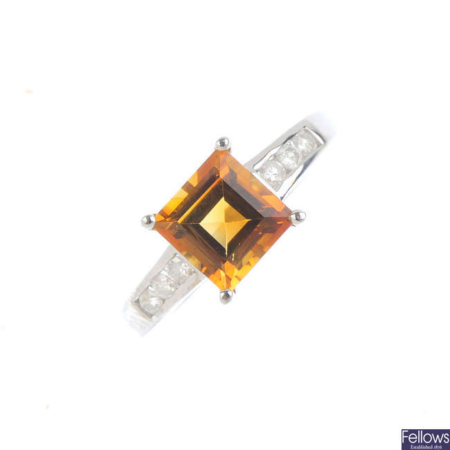 An 18ct gold citrine single-stone and diamond ring.