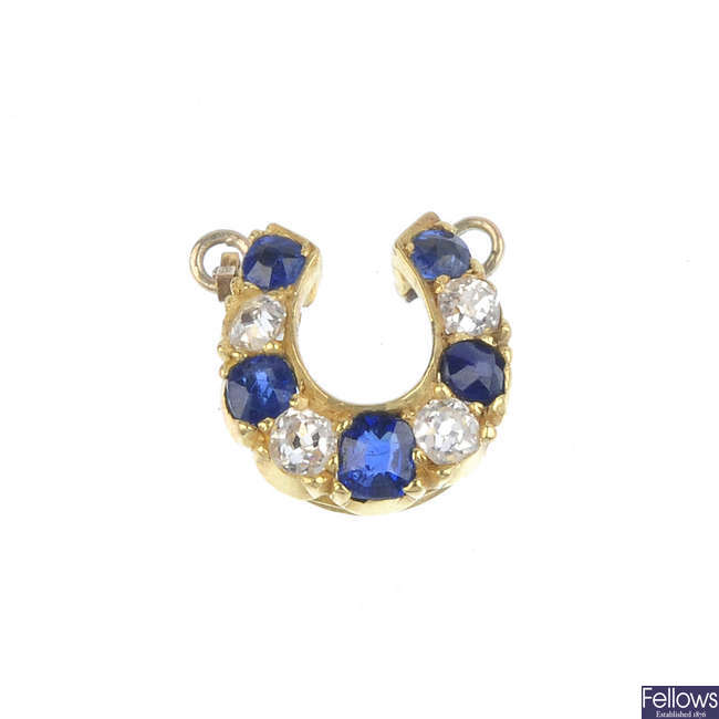 A sapphire and diamond horseshoe pendant.