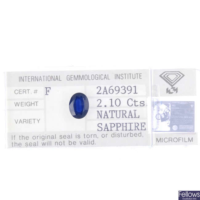 An oval-shape sapphire, weighing 2.10cts.