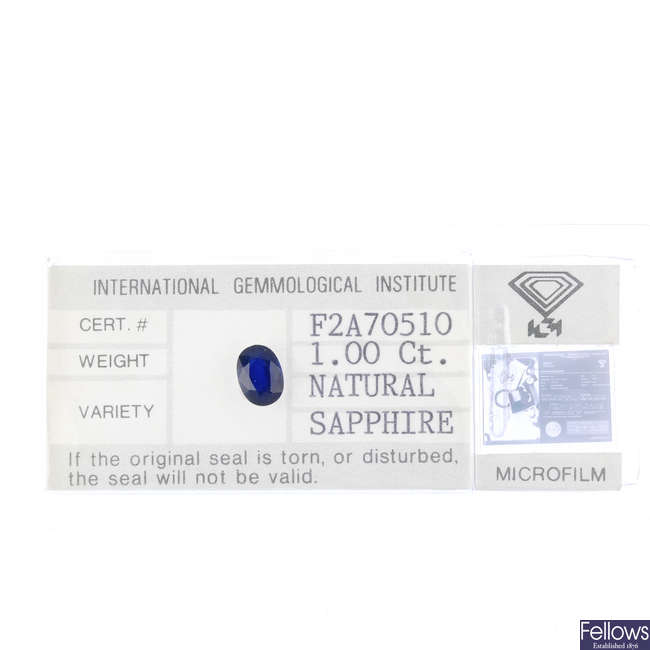 An oval-shape sapphire, weighing 1ct.