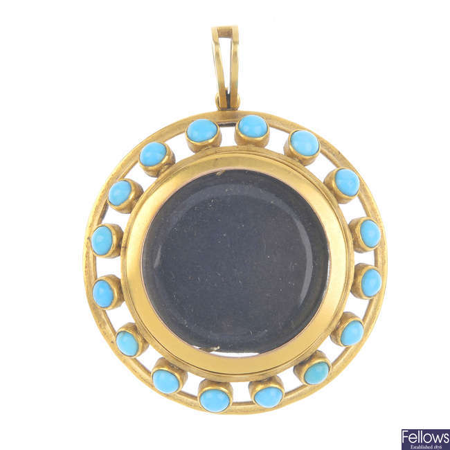 A late Victorian gold and turquoise photograph locket.
