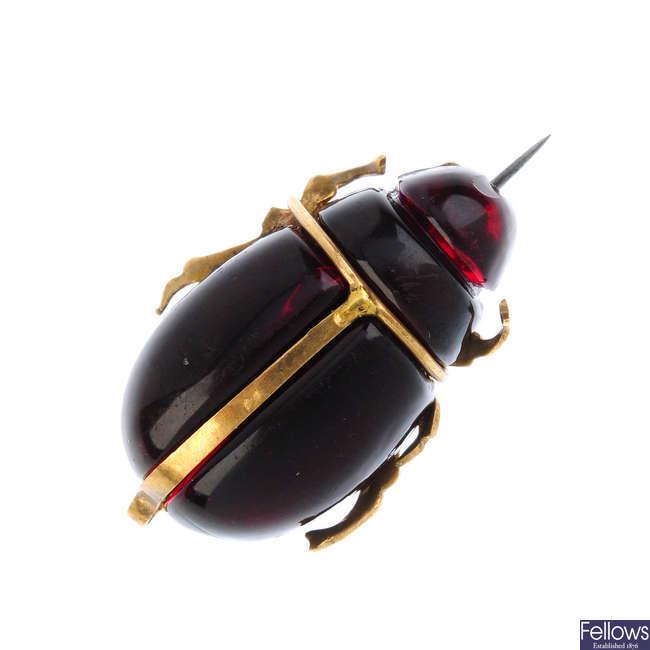 A paste scarab beetle brooch.