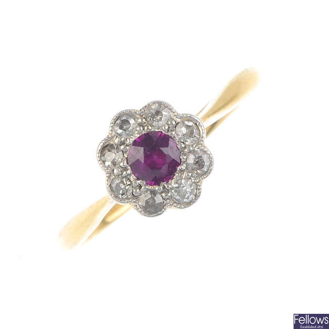 A mid 20th century 18ct gold ruby and diamond floral cluster ring.