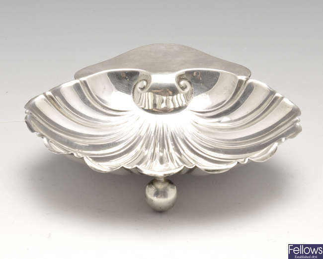 A late Victorian silver shell dish & an Edwardian silver caster.