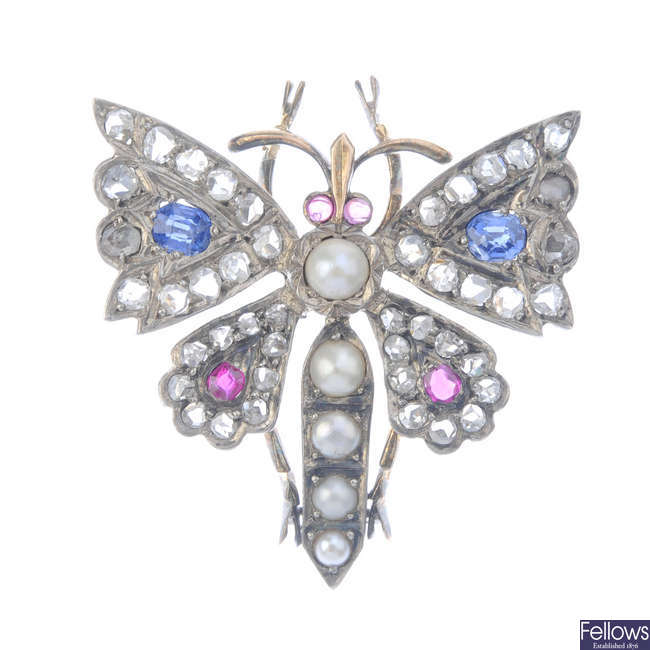 A late Victorian gold and silver split pearl, sapphire, ruby and diamond insect brooch, circa 1880.