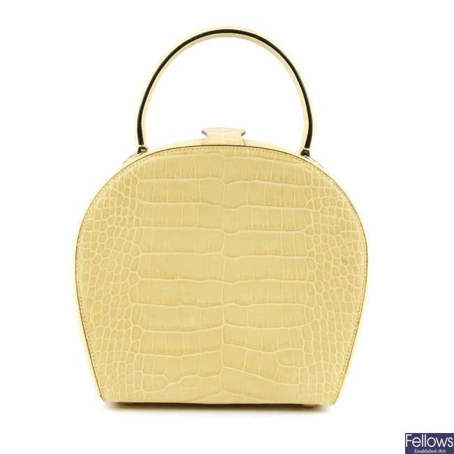 CELINE - an embossed small leather hard case handbag.