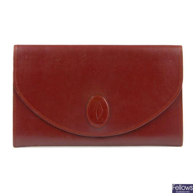 CARTIER - a Must De Cartier envelope clutch.